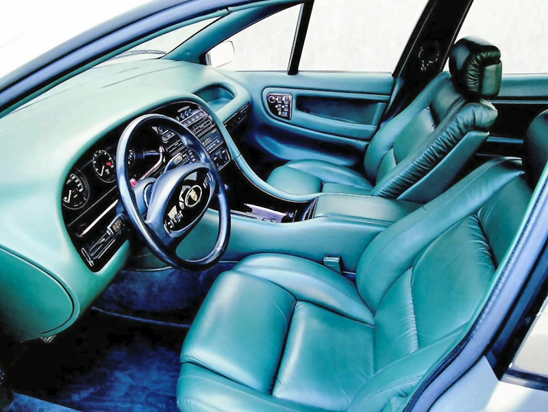 Interior is swoopy and looks similar to the 1989 Lotus Elan, but steering wheel retains the Jaguar character.