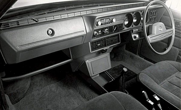 Interior of the top-of-the-range Wolseley model shows extensive use of plush carpeting and wood veneer. Also evident from this shot is just how much the new car had dropped the bus driver driving position of the old 1800/2200 model.