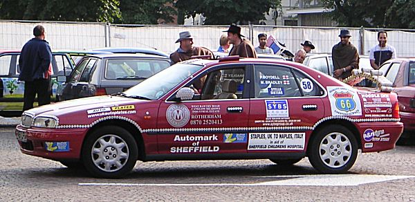 The Rover 618 of team Automark from Sheffield provided a fitting backdrop for a bizaare water-fight in the central piazza in Tirano, Northern Italy...