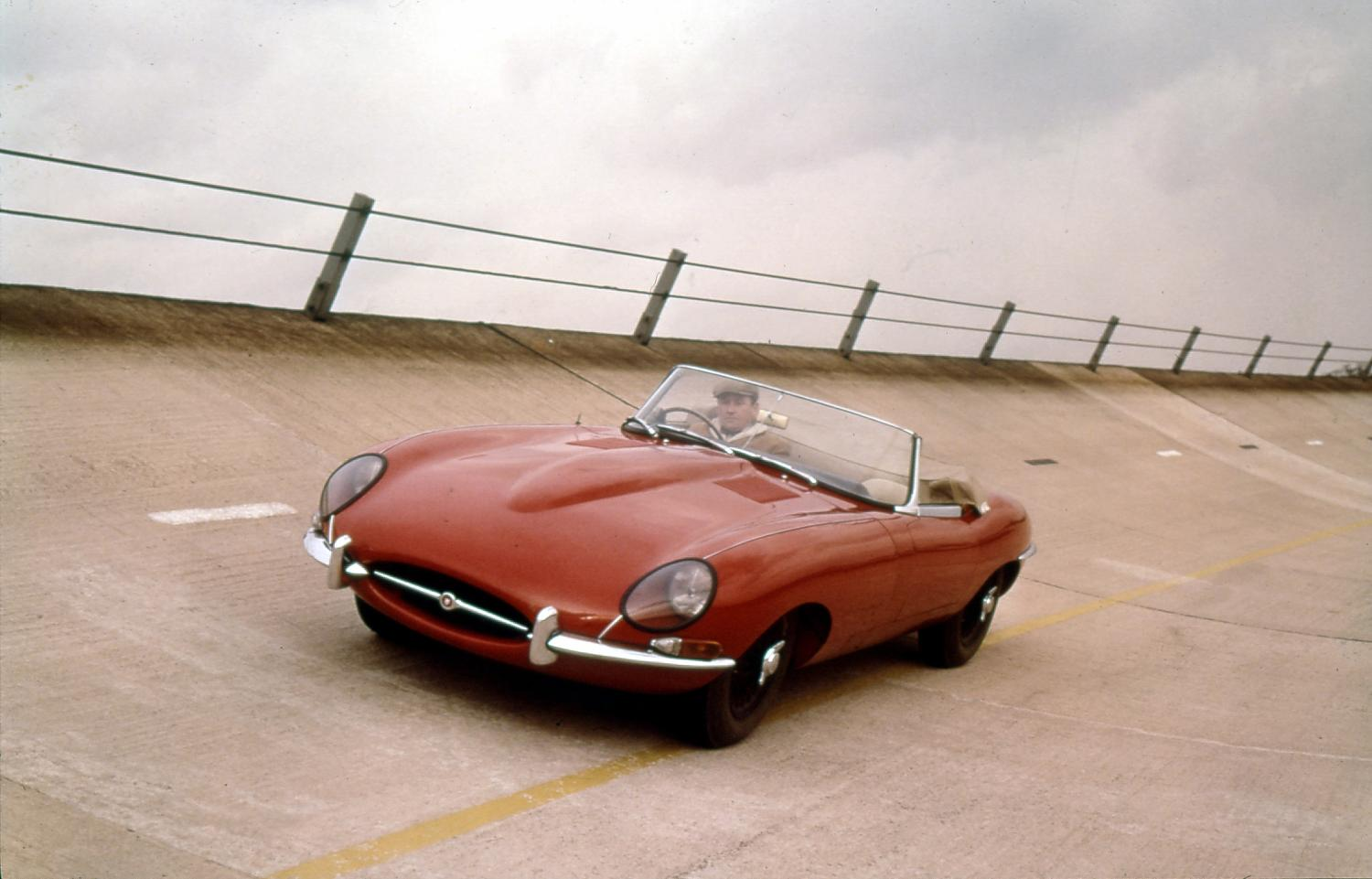 Norman Dewis developed many seminal Jaguar road cars; here he is in 1960 with the legendary E-type