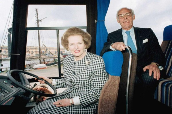 "Maggie and Denis were used to travelling by coach. Here they sit at the wheel of her other ""Battle Bus"" - A Leyland Tiger. Image: Associated Press"