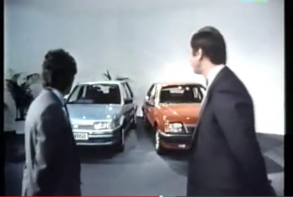 "Peter Egan (on right) plays a ghost like ""super salesman"" who boosts the salesman's flagging attitude. Here they compare the Montego to the runaway success Vauxhall Cavalier."