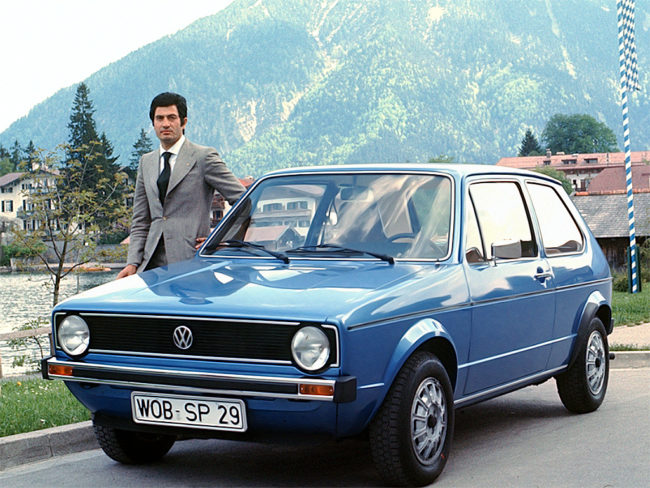 Giorgetto Giugiaro alongside his design masterpiece, the Volkswagen Golf Mk1.