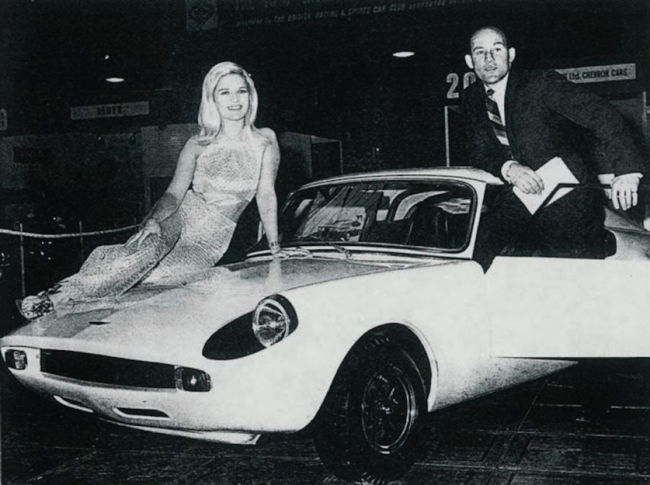 At the 1967 Racing Car Show, Stirling Moss and friend look over a lightweight competition Unipower GT with Minilites and all round disc brakes.